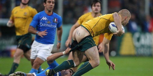 FLORENCE, ITALY - NOVEMBER 20: Drew Mitchell, the Wallaby wing, has his shorts pulled down by Edoardo Gori during the Test match between Italy and the Australian Wallabies at Stadio Artemio Franchi on November 20, 2010 in Florence, Italy. (Photo by David Rogers/Getty Images)